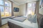 http://sylt-ferienhaus-ferienwohnung.de/wp-content/uploads/2018/05/doppelzimmer-rotkaeppchen-sylt-schlafzimmer-01.jpg
