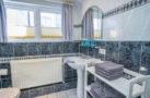 http://sylt-ferienhaus-ferienwohnung.de/wp-content/uploads/2018/05/familienzimmer-frau-holle-sylt-badezimmer-02.jpg