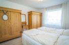 http://sylt-ferienhaus-ferienwohnung.de/wp-content/uploads/2018/05/fewo-wildrose-eg-sylt-schlafzimmer-03.jpg
