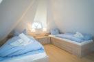 http://sylt-ferienhaus-ferienwohnung.de/wp-content/uploads/2018/07/ferienhaus-milima-schlafraum-01.jpg