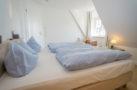 http://sylt-ferienhaus-ferienwohnung.de/wp-content/uploads/2018/07/ferienhaus-milima-schlafzimmer-07.jpg